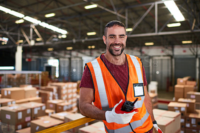 Buy stock photo Portrait of a worker standing in a large warehouse full of boxes