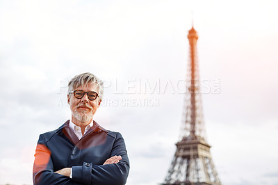 Buy stock photo Portrait of a handsome mature man with the Eiffel Tower in the background