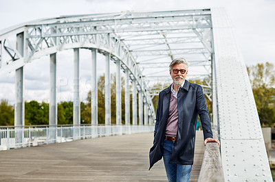 Buy stock photo Portrait of a mature man leaning on the railing of a bridge