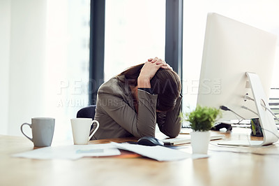 Buy stock photo Cropped shot of a young businesswoman looking stressed out while working in an office
