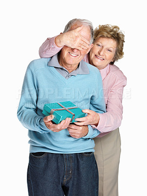 Buy stock photo Portrait of a happy mature woman covering senior man's eyes to surprise him with a gift