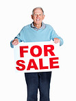 Happy mature man holding sale sign against white background