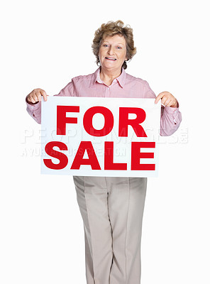 Buy stock photo Portrait of a happy senior woman holding sale sign against white background