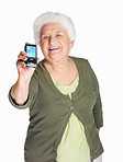 Happy mature woman displaying her mobile isolated on white