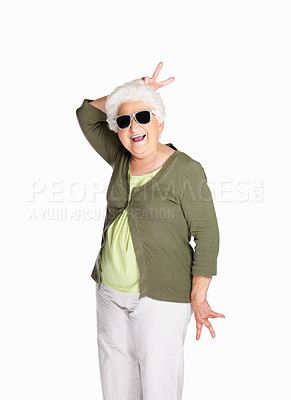 Buy stock photo Portrait of a naughty senior female wearing sunglasses isolated against white