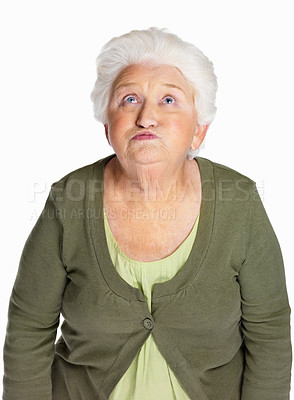 Buy stock photo Portrait of a mature woman making funny face isolated against white