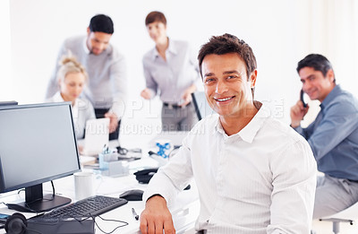 Buy stock photo Portrait of happy business man with his colleagues in background during meeting