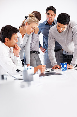 Buy stock photo Team of confident professionals discussing plan in conference room