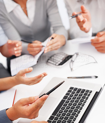 Buy stock photo Cropped view of business people discussing project on laptop during meeting