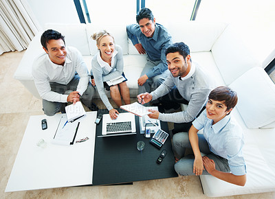 Buy stock photo High angle view of female leader with her team working on laptop during business meeting