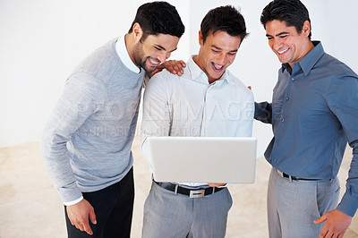 Buy stock photo Male leader with his team working together on laptop