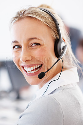 Buy stock photo Closeup of cheerful customer service representative wearing headset and smiling