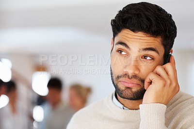 Buy stock photo Business man having conversation on cellphone with colleagues in blurred background