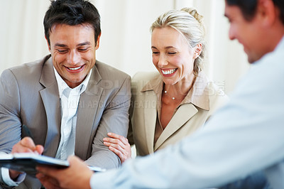 Buy stock photo Focus on happy couple discussing investment plans with consultant