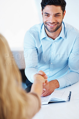 Buy stock photo Smart business man shaking hands with colleague