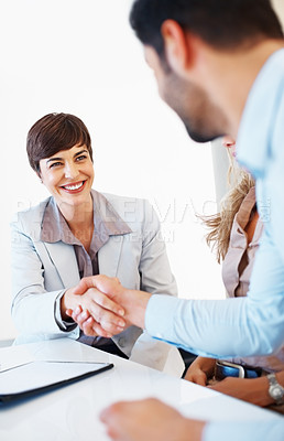 Buy stock photo Business woman shaking hands with male colleague during meeting