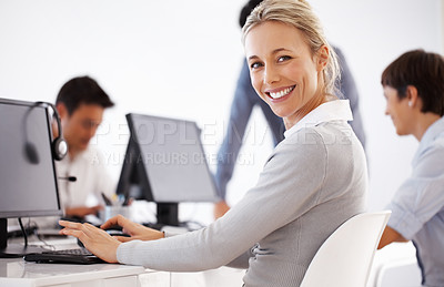 Buy stock photo Portrait of smiling business woman working with colleagues in background