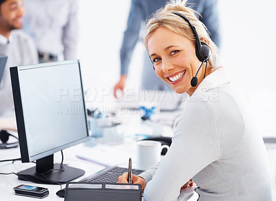 Buy stock photo Smiling call center executive using headset and working on computer