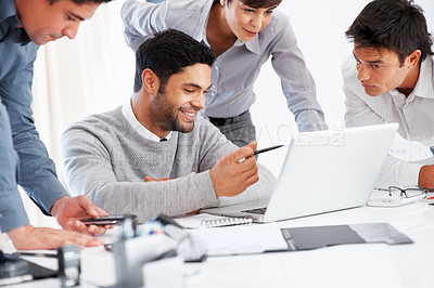 Buy stock photo Business man explaining project to his colleagues on laptop