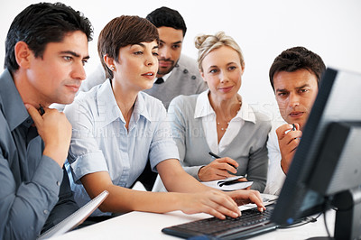 Buy stock photo Female leader with her team preparing presentation on computer