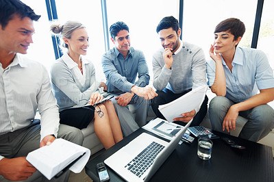 Buy stock photo Group of business people with paperwork during corporate meeting