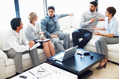 Buy stock photo Female executive sharing her ideas to her colleagues during business meeting