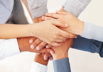 Buy stock photo Closeup of successful business people with hands on top of each other