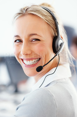 Buy stock photo Closeup of an attractive customer care consultant looking at you and smiling happily