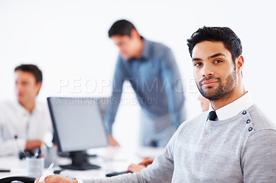 Buy stock photo Confident male executive with colleagues in background