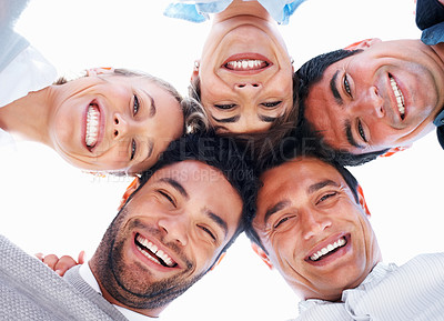 Buy stock photo Closeup of happy business people with their heads together on white background