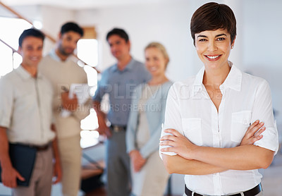 Buy stock photo Beautiful business woman smiling with colleagues in background