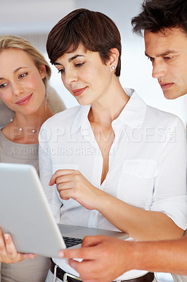 Buy stock photo Confident business woman using laptop with her colleagues