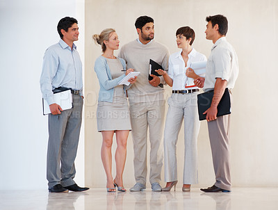 Buy stock photo Full length of business colleagues standing together and communicating with each other