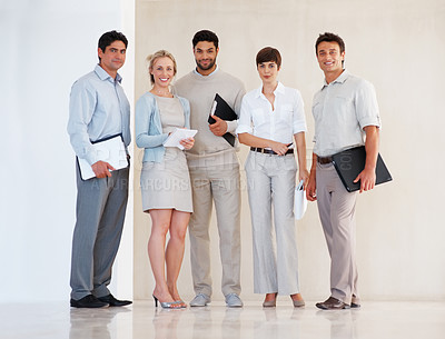 Buy stock photo Full length of business team standing together and smiling