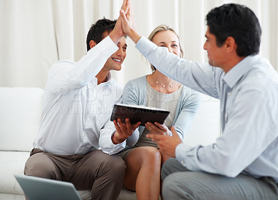 Buy stock photo Couple holding investment contract with man giving high-five to business consultant