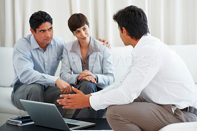 Buy stock photo Financial advisor discussing new plans with business couple using laptop
