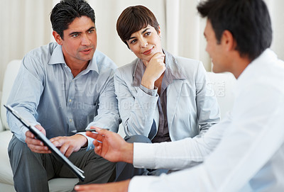 Buy stock photo Couple discussing financial matter with consultant