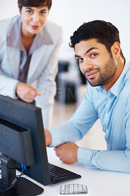 Buy stock photo Portrait of business colleagues working on computer and looking at you