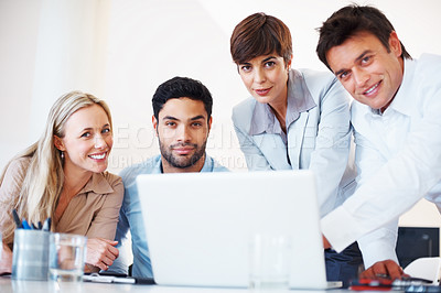Buy stock photo Portrait of business colleagues sitting at table with laptop and looking at you