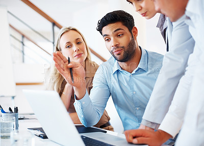 Buy stock photo Business man sitting at table and discussing project on laptop with colleagues