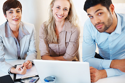 Buy stock photo Portrait of business colleagues sitting at table using laptop and looking at you