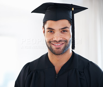 Buy stock photo Closeup portrait of young man in graduation gown and hat smiling