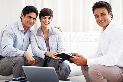 Buy stock photo Beautiful business couple with financial consultant holding signing contract