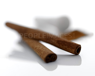 Buy stock photo Two spicy cinnamon sticks isolated on white background