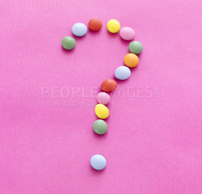 Buy stock photo Diet concept  - Question mark made of multicolored candy sweets on pink background