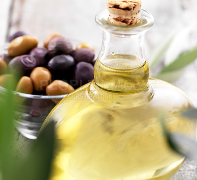 Buy stock photo Closeup of bottle of olive oil and a bowl with black and green olives