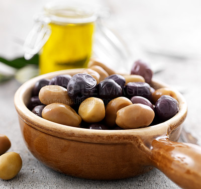 Buy stock photo Closeup of bowl full of green and dry black olives