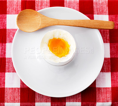 Buy stock photo Soft boiled egg in ceramic eggcup with wooden spoon on dining table