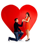 Valentines day - Handsome young man proposing marriage to a woman