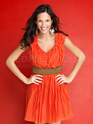 Buy stock photo Portrait of pretty young woman smiling against red background